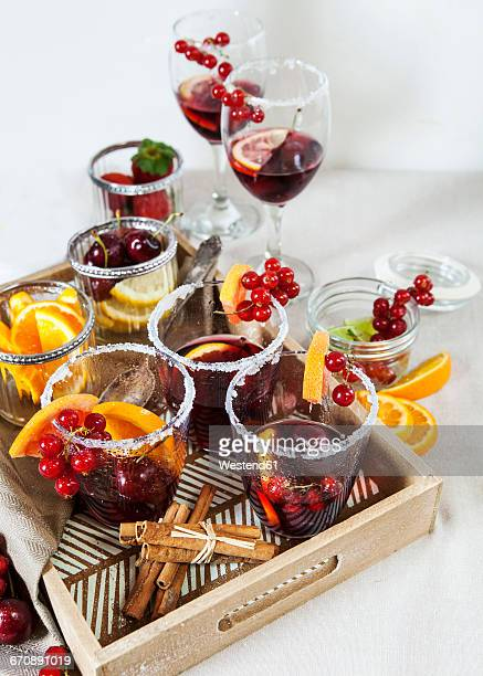 Glasses of Sangria with cherries, red currants and orange slices