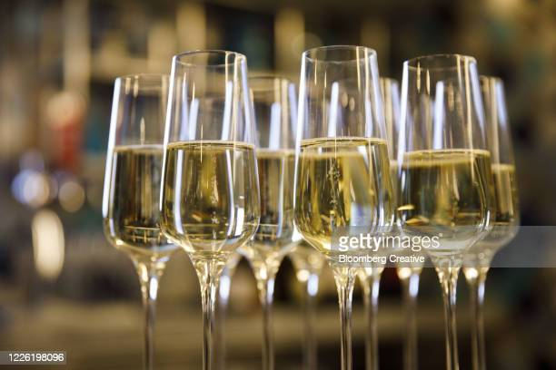 glasses of sparking wine - happy hour stock pictures, royalty-free photos & images