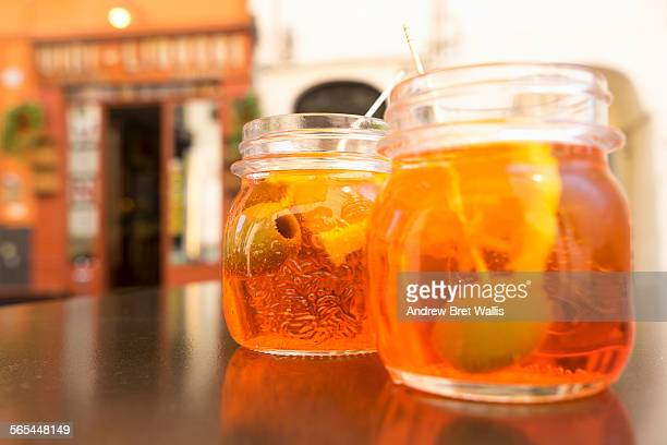 Glasses of aperol spritz on an outdoor cafe table