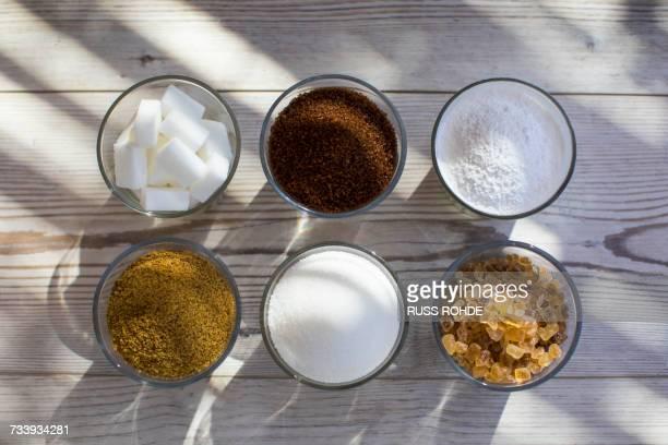 glasses of sugar in various forms, overhead view - zucker stock-fotos und bilder