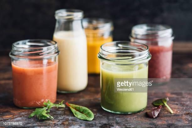 glasses of various smoothies - トロピカルフルーツ ストックフォトと画像