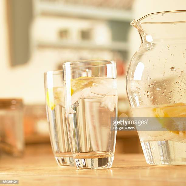 Glasses of water on table top.