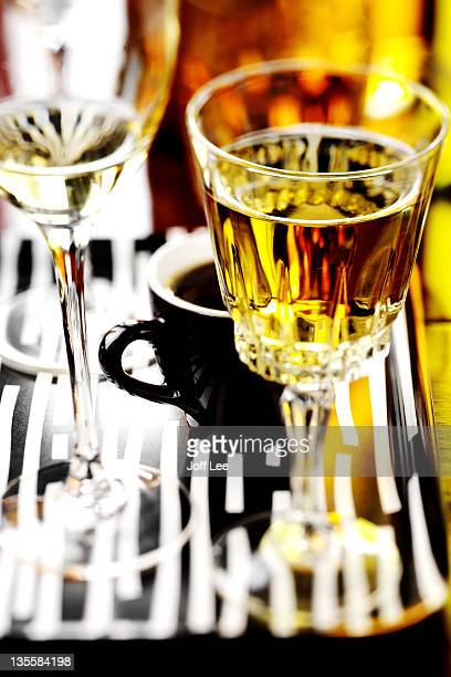 Glasses of white wine,sherry and a cup of coffee