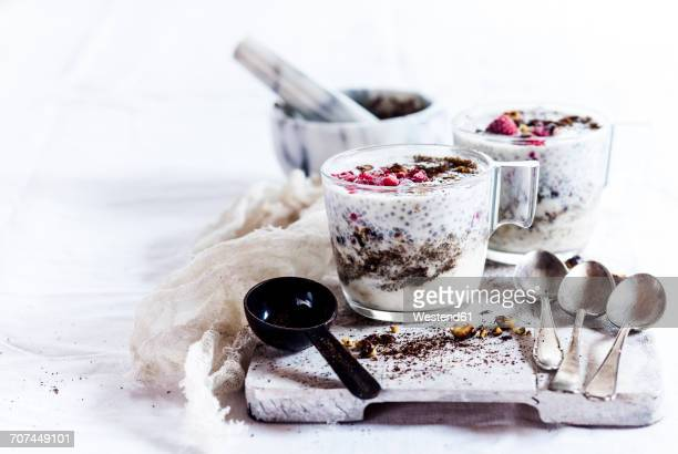 glasses of yogurt dessert with chia, roasted hazelnuts and coffee - measuring spoon stock pictures, royalty-free photos & images
