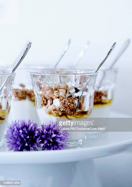 Glasses of yogurt, granola and honey