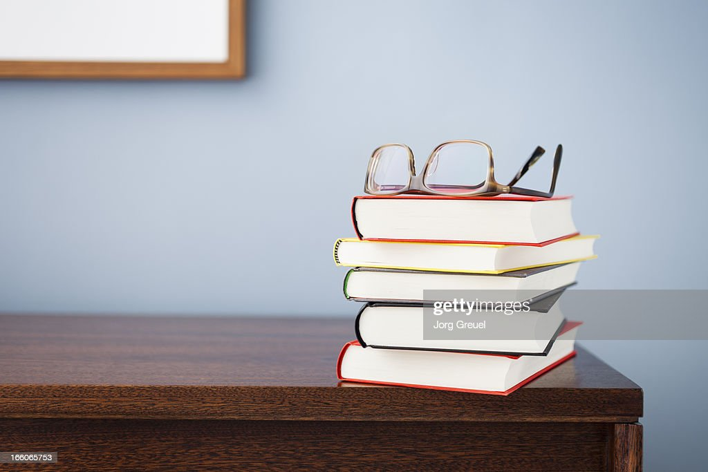 Glasses on a stack of books : Stock Photo