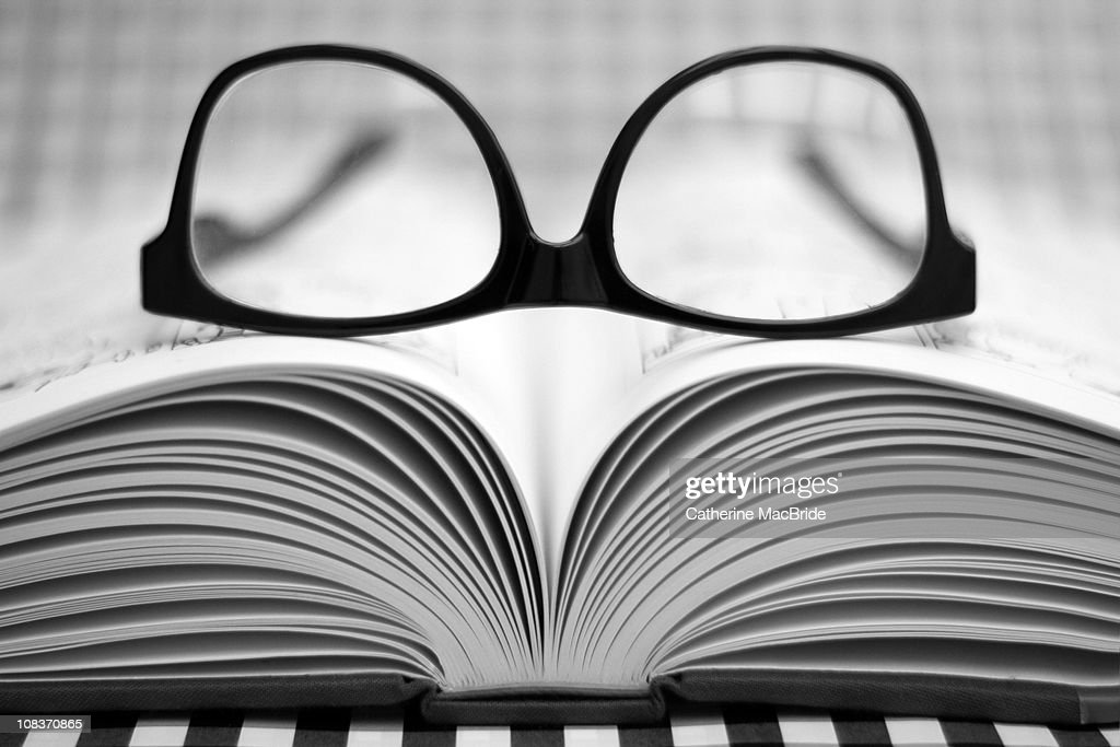 Glasses on an open Book : Stock Photo