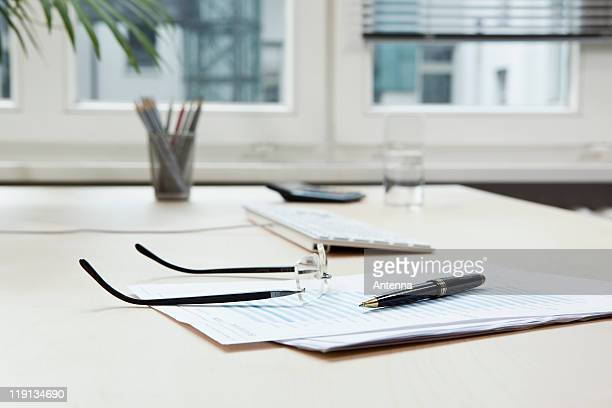 Glasses on desk & office equipment