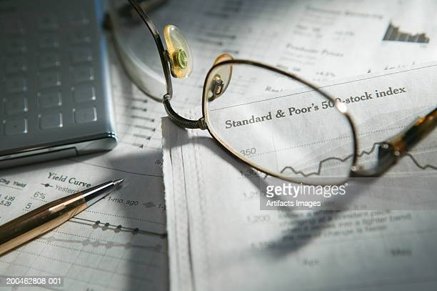 glasses on top of documents with pen and calculator - western script stock pictures, royalty-free photos & images