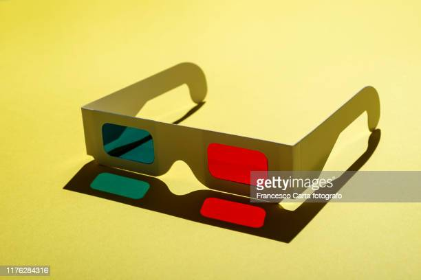 3-d glasses - blue film video stock pictures, royalty-free photos & images