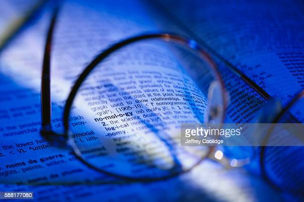 Glasses Resting on Dictionary