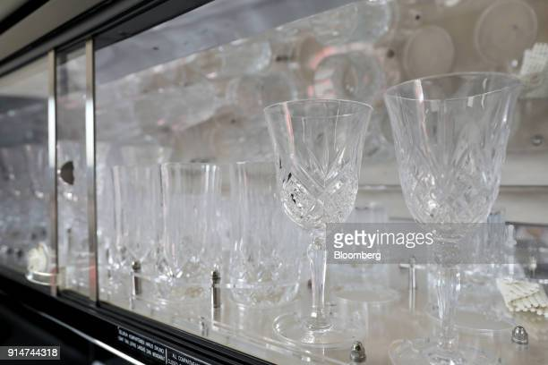 Glasses sit inside an Embraer SA Legacy 650E jet during the Singapore Airshow held at the Changi Exhibition Centre in Singapore on Tuesday Feb 6 2018...