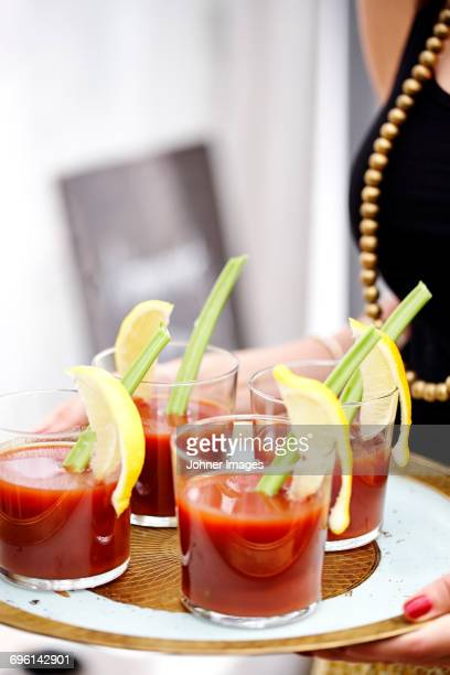 glasses with bloody mary on tray - bloody mary stock photos and pictures