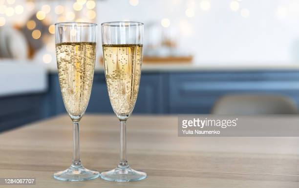 glasses with champagne on the background of christmas decorations. - honour stock pictures, royalty-free photos & images