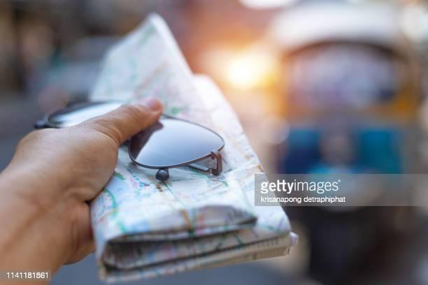 glasses with maps,travel in bangkok,thailand. - geografia fisica foto e immagini stock