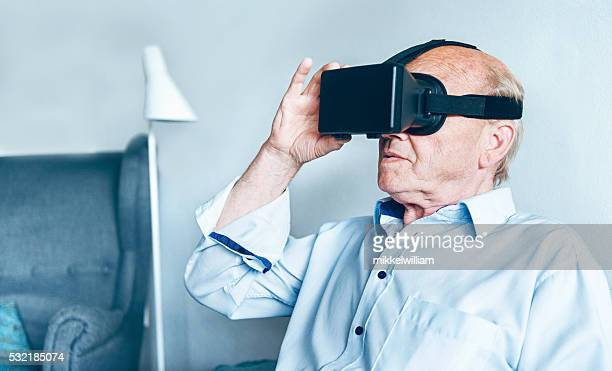 VR glasses worn by senior man at home