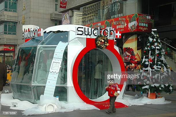 A glassmade icehouse debuts outside of a shopping mall on December 23 2006 in Hangzhou Zhejiang Province China While Christmas Day is not a public...