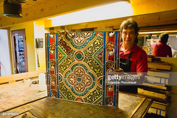 Glassmaker Gerard Geiss Holding Stained Glass Window