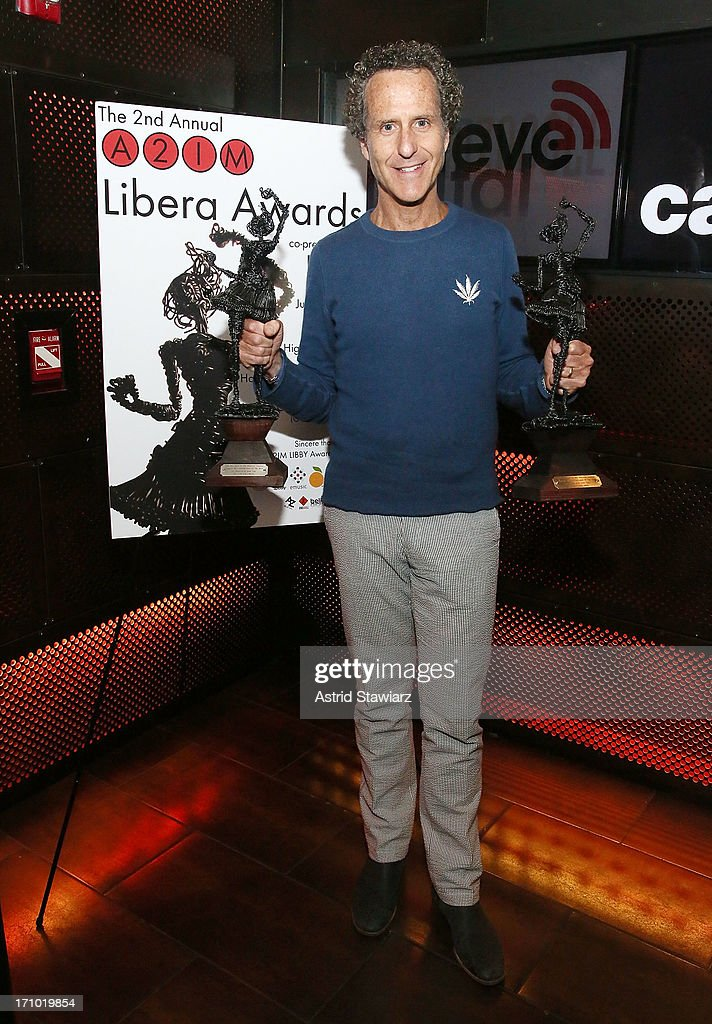 GlassNote Entertainment Group CEO Daniel Glass poses for photos after receiving a libera award for most creative marketing campaign for Mumford & Sons at the 2nd Annual Libera Awards at Highline Ballroom on June 20, 2013 in New York City.