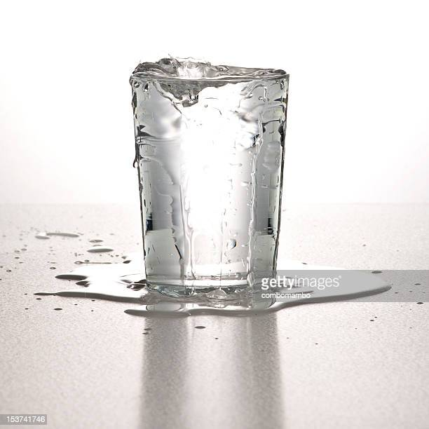 glassofwater3 - overflowing stock pictures, royalty-free photos & images