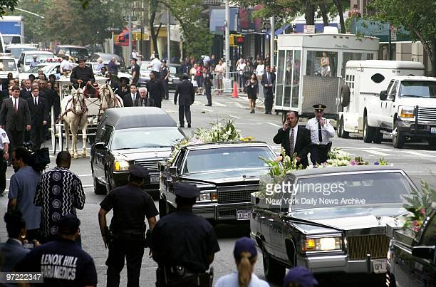 A glasspaneled carriage pulled by a pair of creamcolored horses bears the casket of RB star Aaliyah along Madison Ave from the Frank E Campbell...