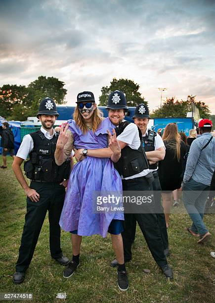 Glastonbury Festival 2015 A fun intereaction between the police and a young festival goer in face paint and a dress