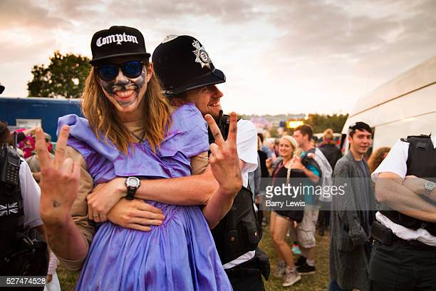 Glastonbury Festival 2015 A fun intereaction between the police and a young festival goer in a dress and face paint