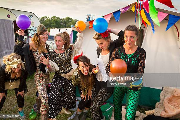 Glastonbury Festival 2015 Group of girls all dressed up inhaling baloons of nitrous oxide or laughing gas in the camping grounds before the big night...