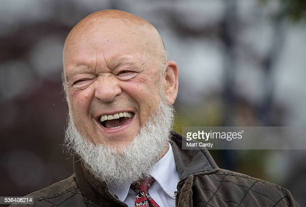 Glastonbury Festival founder and president of the Bath and West Show Michael Eavis laughs as he attends a opening ceremony on the opening day of the...