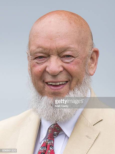 Glastonbury Festival founder and president of the Bath and West Show Michael Eavis laughs as he attends an opening ceremony on the opening day of the...