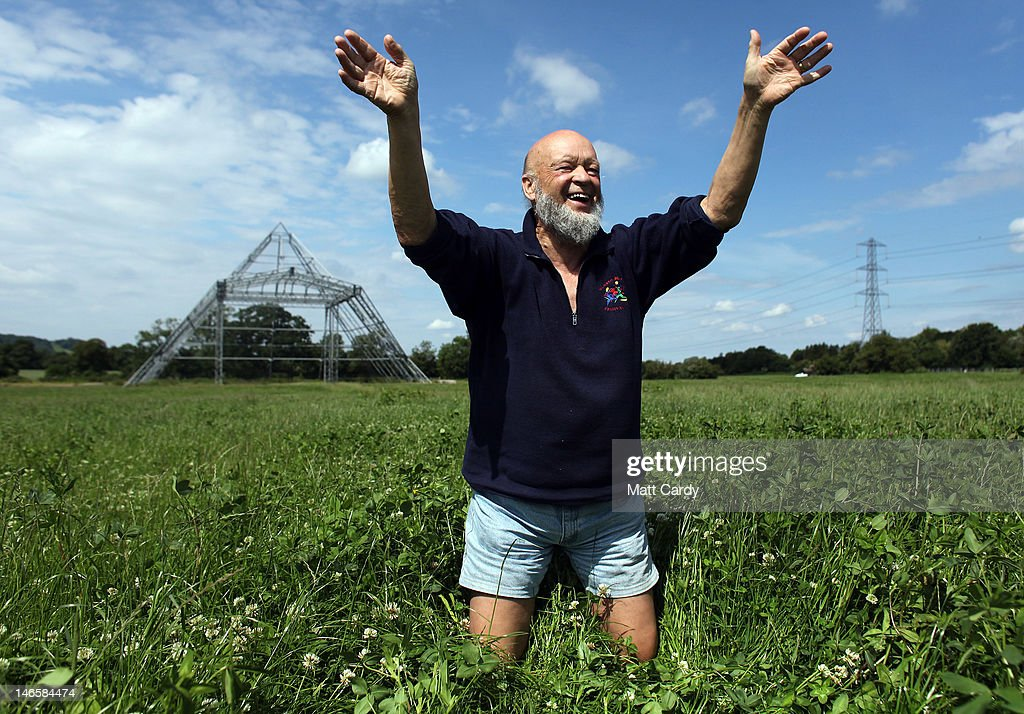 Glastonbury Festival founder Michael Eavis waves as he stands in a field of uncut grass in front of the skeleton of the main Pyramid Stage at the Glastonbury Festival site at Worthy Farm, Pilton on June 20, 2012 near Glastonbury, England. Today would have been the day that the gates would have opened for what has become Europe's biggest music festival, but because of the London 2012 Olympics it was decided by the organisers to take this year off. However, this week it was announced that the festival - which started in 1970 when several hundred festival-goers paid 1 GBP to watch Marc Bolan and has now attracts more than 175,000 people over five days - will feature in a mosh-pit style tribute in the opening ceremony of the London 2012 Olympic Games. The Festival will return in June 2013.