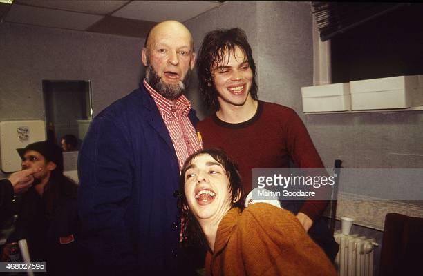 Glastonbury organiser Michael Eavis with Gaz Coombes and Danny Goffey of Supergrass, backstage, London, United Kingdom, 2000.