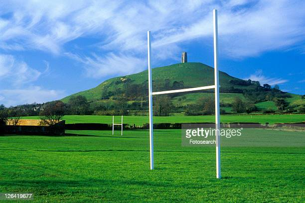 Glastonbury Tor, A sacred site along the English countryside, England and goal posts in green field