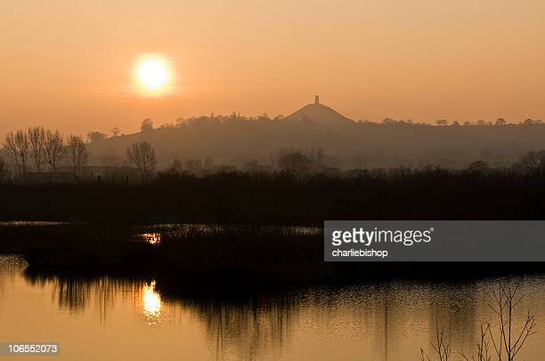 glastonbury tor england at sunset - arthur stock pictures, royalty-free photos & images