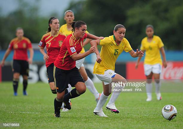 Glaucia of Brazil is challenged by Laura Gutierrez of Spain during the FIFA U17 Women's World Cup Quarter Final match between Spain and Brazil at the...