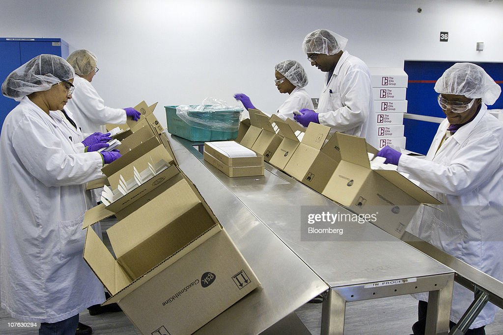 GlaxoSmithKline Canada Inc. employees package bottles of Ziagen, an HIV oral liquid medication, on the packaging line at the company's Canadian headquarters in Mississauga, Ontario, Canada, on Monday, Dec. 13, 2010. Global sales of existing HIV medicines will peak at $12 billion in 2012, then halve by 2019 as patent expiries increase competition from generic drugs, according to a report by Datamonitor Group earlier this year. Photographer: Norm Betts/Bloomberg via Getty Images