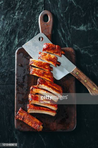 glazed barbecued pork ribs - sparerib stock photos and pictures