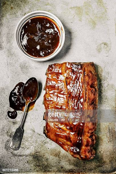 glazed barbecued pork ribs - barbeque sauce stock photos and pictures