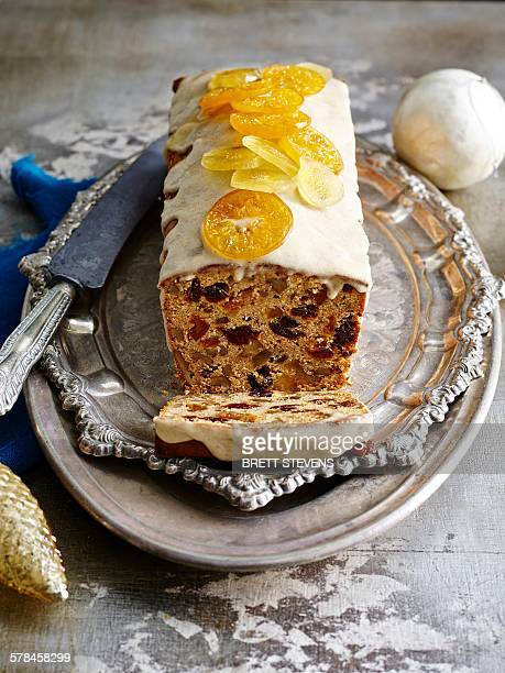 Glazed Chile Pan De Pascua with orange slices on silver serving dish with christmas baubles