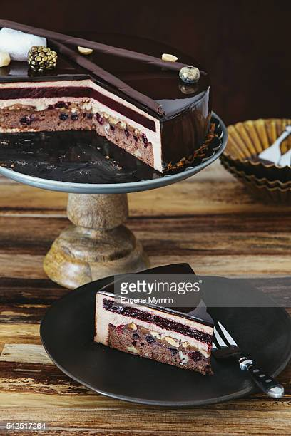 Glazed chocolate mousse cake with nuts and berries