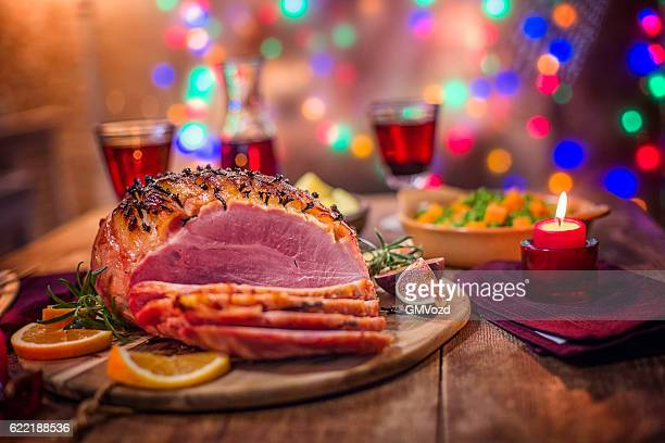 glazed holiday ham with cloves served for dinner - glazed ham stock pictures, royalty-free photos & images