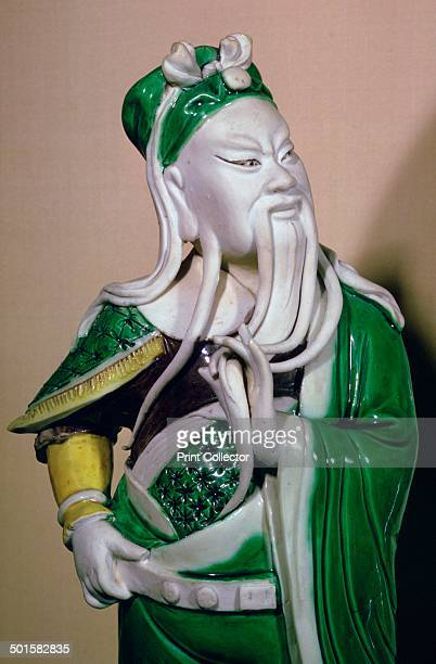 A glazed porcelain figure of Kuanti a Taoist war deity From the period of K'ang His currently in the Victoria and Albert Museum's collection 17th...
