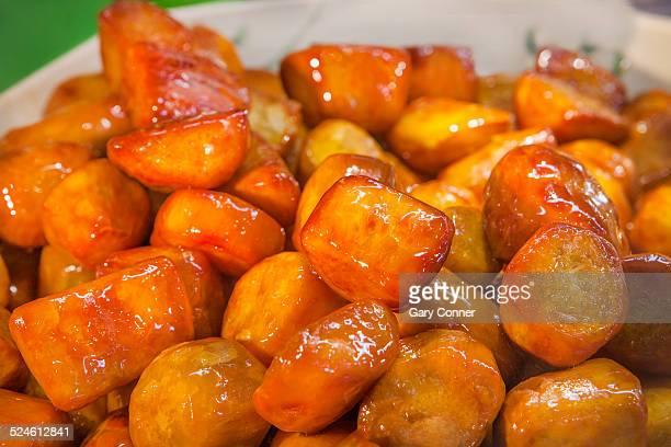 glazed sweet potatoe pieces - glazed food stock pictures, royalty-free photos & images