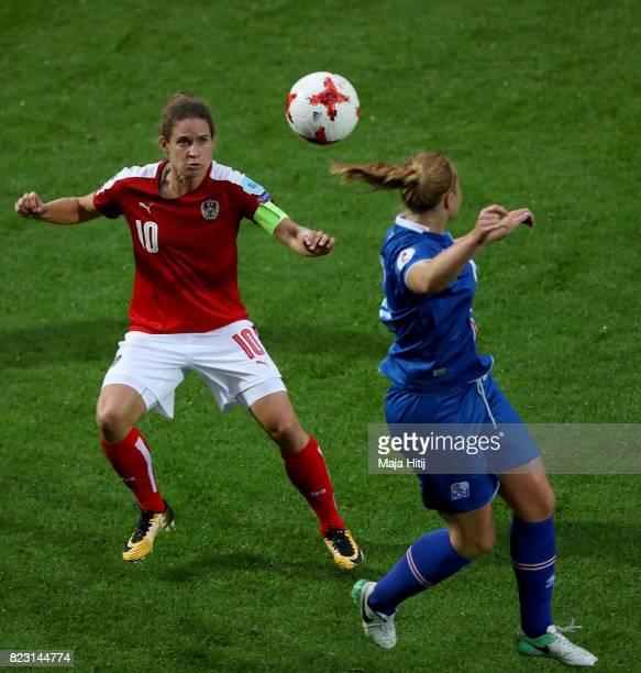 Glódís Viggósdóttir of Iceland and Nina Burger of Austria compete for the ball during the Group C match between Iceland and Austria during the UEFA...