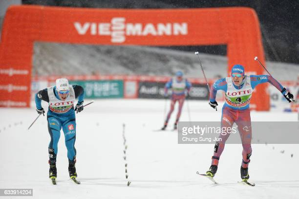 Gleb Retivykh of Russia and Lucas Chanavat of France compete in the Men 6x15km Team Sprint Final during the FIS Nordic Combined World Cup presented...