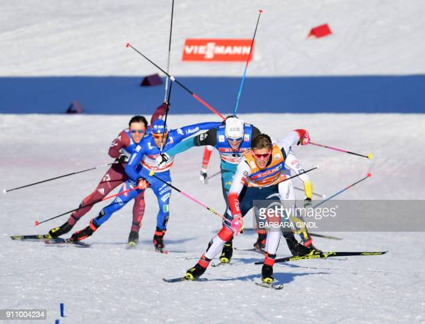 Gleb Retivykh of Russia Federico Pellegrino of Italy Lucas Chanavat of France and Johannes Hoesflot Klaebo of Norway compete in the men's sprint of...
