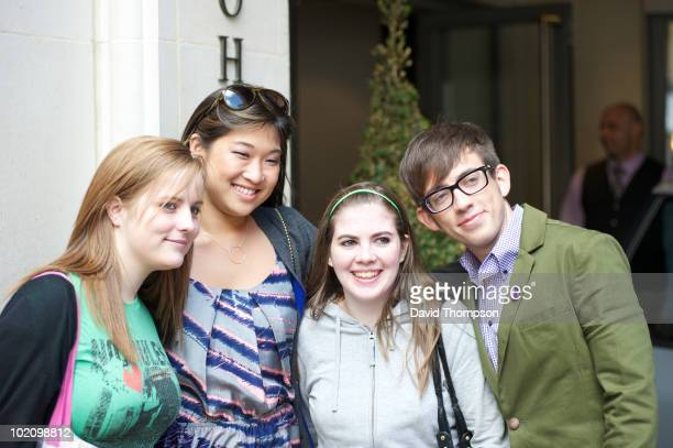 Glee cast member Jenna Ushkowitz poses with fans as she leaves her hotel on June 15, 2010 in London, England.