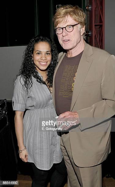 Gleendilys Inoa and Robert Redford attend the opening night of BAMcinemaFEST at the Howard Gilman Opera House on June 17, 2009 in New York City.
