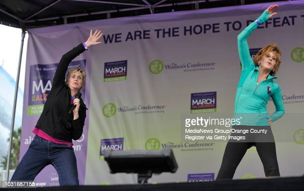 USA Glee's Jany Lynch left and Jane Fonda help warm up the crowd before Maria Shriver's March on Alzheimer's in Downtown Long Beach CA on October 24...