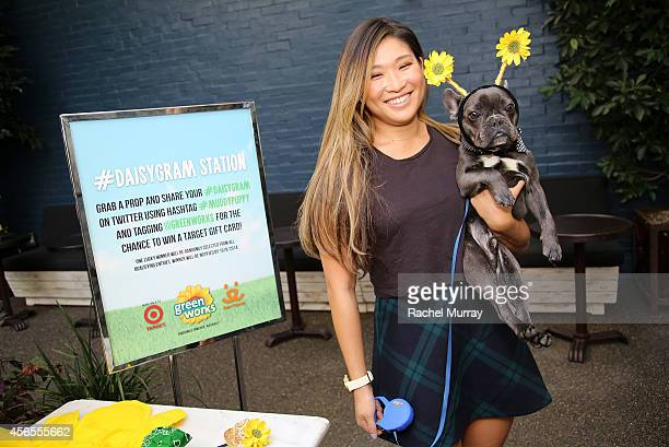 "Glee's"" Jenna Ushkowitz and her dog Bear pick props for a #Daisygram during the Green Works Muddy Puppy video premiere at the Palihouse Hotel in Los..."